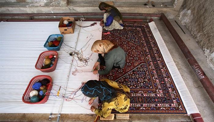 lavorazione tappeto persiano