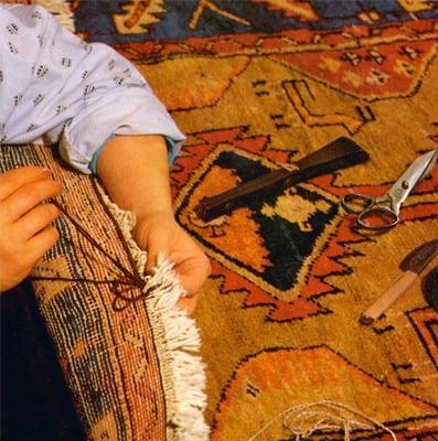 fermatura frangia restauro tappeto